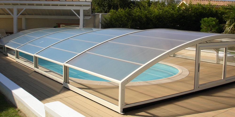 G nie un abri bas pour votre piscine par aladdin concept for Aladdin abri piscine